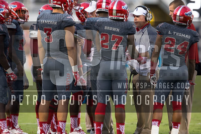 FAU Offensive coach talks to his team during the football  game between the visiting Western Kentucky Hilltoppers  and the FAU Owls on October 29, 2016  ( Joe Petro, The Skyboat )
