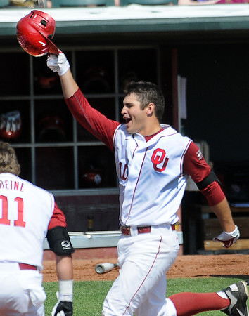 """Oklahoma's Garrett Carey tips his helmet as he heads for home Wednesday, May 22, 2012, after his walk-off homerun gave the Sooners a 1-0 win over Oklahoma State in the opening round of the Big 12 championship at the Chickasaw Bricktown Ballpark. Additional photos can be viewed here <a href=""""http://photos.NormanTranscript.com/College"""">http://photos.NormanTranscript.com/College</a> Sports Jerry Laizure/The Transcript"""
