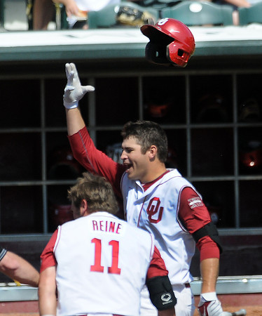 """Oklahoma's Garrett Carey tosses his helmet in the air as he heads for home Wednesday, May 22, 2012, after his walk-off homerun gave the Sooners a 1-0 win over Oklahoma State in the opening round of the Big 12 championship at the Chickasaw Bricktown Ballpark. Additional photos can be viewed here <a href=""""http://photos.NormanTranscript.com/College"""">http://photos.NormanTranscript.com/College</a> Sports Jerry Laizure/The Transcript"""