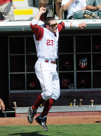 """Oklahoma's Hunter Lockwood celebrates the Sooners's 1-0 win over Oklahoma State Wednesday, May 22, 2012, in the opening round of the Big 12 championship at the Chickasaw Bricktown Ballpark. Additional photos can be viewed here <a href=""""http://photos.NormanTranscript.com/College"""">http://photos.NormanTranscript.com/College</a> Sports Jerry Laizure/The Transcript"""
