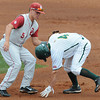 Oklahoma shortstop Caleb Bushyhead puts a tag on Baylor's Nathan Orf  Saturday, May 26, 2012, in the Big 12 baseball championship at the Chickasaw Bricktown Ballpark in Oklahoma City. Jerry Laizure/The Transcript
