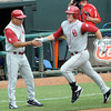 Oklahoma coach Sunny Golloway congratulates designated hitter Matt Oberste after he hit his second homerun of the game against Baylor Saturday, May 26, 2012, in the Big 12 baseball championship at the Chickasaw Bricktown Ballpark in Oklahoma City. Jerry Laizure/The Transcript