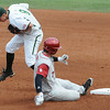 Oklahoma's Max White (7) slides safely into second as Baylor second baseman Lawton Langford bobbles the ball Saturday, May 26, 2012, in the Big 12 baseball championship at the Chickasaw Bricktown Ballpark in Oklahoma City. Jerry Laizure/The Transcript