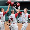 Oklahoma players Caleb Bushyhead, Tanner Toal and Matt Oberste bump helmets Saturday, May 26, 2012, after Oberste's homer against Baylor in the Big 12 baseball championship at the Chickasaw Bricktown Ballpark in Oklahoma City. Jerry Laizure/The Transcript