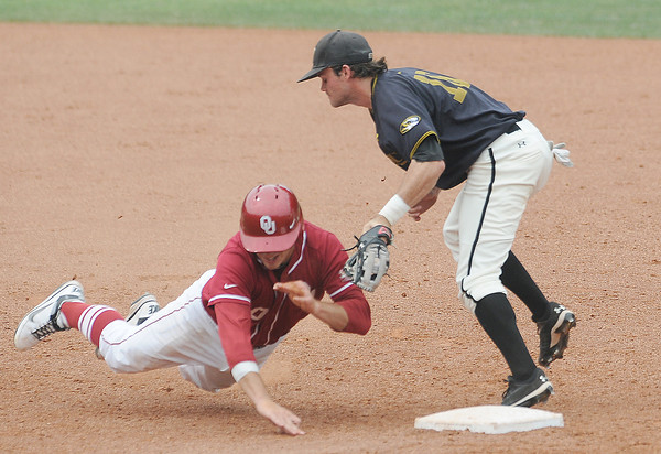 Oklahoma's Garrett Carey is tagged out by Missouri second baseman Dillon Everett (16) Sunday, May 27, 2012, in the title game of the Big 12 baseball championship at the Chickasaw Bricktown Ballpark in Oklahoma City. Jerry Laizure/The TranscriptSunday, May 27, 2012, in the title game of the Big 12 baseball championship at the Chickasaw Bricktown Ballpark in Oklahoma City. Jerry Laizure/The Transcript