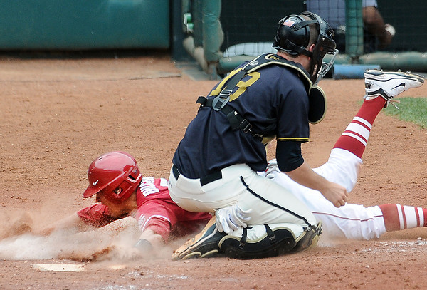 Oklahoma's Caleb Bushyhead is tagged out at home by Missouri catcher Ben Turner Sunday, May 27, 2012, in the title game of the Big 12 baseball championship at the Chickasaw Bricktown Ballpark in Oklahoma City. Jerry Laizure/The TranscriptSunday, May 27, 2012, in the title game of the Big 12 baseball championship at the Chickasaw Bricktown Ballpark in Oklahoma City. Jerry Laizure/The Transcript