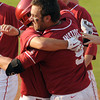 Oklahoma's Evan Mistich gets a hug from a teammate after his infield single drove in the winning run Thursday, May 24, 2012, giving the Sooners a 3-2 win over Baylor in the second round of the Big 12 championship at the Chickasaw Bricktown Ballpark. Jerry Laizure/The Transcript