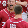 Oklahoma players Tanner Toal and Erik Ross (6) celebrate OU's 3-2 win over Baylor Thursday, May 24, 2012, in the second round of the Big 12 championship at the Chickasaw Bricktown Ballpark. Jerry Laizure/The Transcript