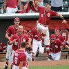 Oklahoma players empty the dugout Thursday, May 24, 2012, after Evan Mistich's rbi-single in the bottom of the ninth inning gave OU a 3-2 win over Baylor in the second round of the Big 12 championship at the Chickasaw Bricktown Ballpark. Jerry Laizure/The Transcript