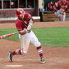 Oklahoma's Evan Mistich connects on an infield single that drove in the winning run Thursday, May 24, 2012, giving the Sooners a 3-2 win over Baylor in the second round of the Big 12 championship at the Chickasaw Bricktown Ballpark. Jerry Laizure/The Transcript