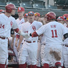 The Sooner bench congratulates Cody Reine as he comes back to the dugout after bringing in a run on a sacrifice hit Thursday during the Sooners' game against the bulldogs at L. Dale Mitchell Park.  For more photos from the game visit Photos.NormanTranscript.com<br /> Kyle Phillips/The Transcript