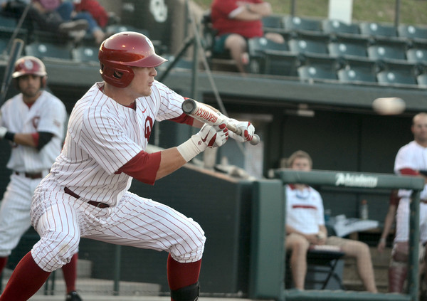 OU infielder Matt Oberste bunts the ball Thursday during the Sooners' game against Samford at L. Dale Mitchell Park.  For more photos from the game visit Photos.NormanTranscript.com<br /> Kyle Phillips/The Transcript