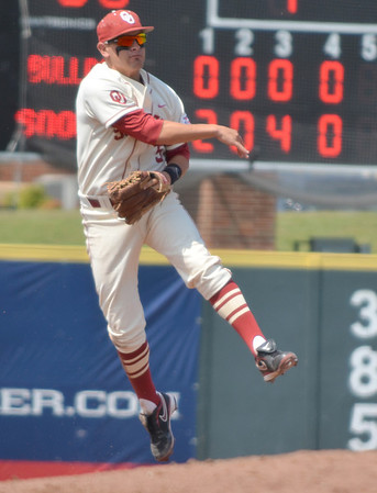 OU infielder Caleb Bushyhead throws the ball to first after picking up a ground ball Saturday during the Sooners' game against Samford Saturday at L. Dale Mitchell Park.<br /> Kyle Phillips/The Transcript