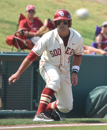 OU's Evan Mistich runs down the third-base line as the Samford pitcher throws to the plate during the Sooners' game against the Bulldogs Saturday at L. Dale Mitchell Park.<br /> Kyle Phillips/The Transcript