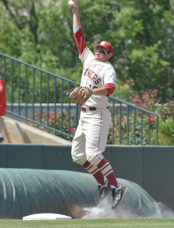 OU infielder Garrett Carey grabs a ground ball Saturday during the Sooners' game against Samford at L. Dale Mitchell Park.<br /> Kyle Phillips/The Transcript