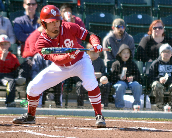 OU infielder Jack Mayfield bunts the ball Saturday duing the Sooners' game against Pepperdine at L. Dale Mitchell Park.<br /> Kyle Phillips/The Transcript