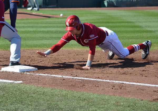 OU infielder Kolbey Carpenter dives into first base to avoid veing picked off  Saturday during the Sooners' game against Pepperdine at L. Dale Mitchell Park.<br /> Kyle Phillips/The Transcript