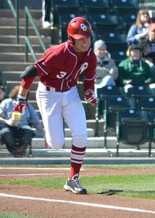 OU outfielder Craig Aikin takes off for first base after getting a hit Saturday duing the Sooners' game against Pepperdine at L. Dale Mitchell Park.<br /> Kyle Phillips/The Transcript
