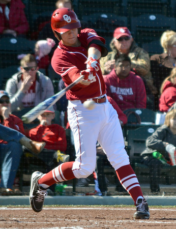 OU infielder Kolbey Carpenter makes contact with the ball during his turn at bat in the second inning  Saturday during the Sooners' game against Pepperdine at L. Dale Mitchell Park.<br /> Kyle Phillips/The Transcript