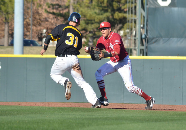Oklahoma infielder 	Hector Lorenzana tags out a Arkansas Pine Bluff player Tuesday during the Sooner's game against the Lions at L. Dale Mitchell Park.<br /> Kyle Phillips/The Transcript