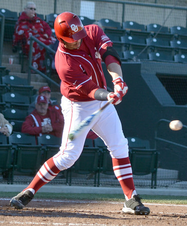 Oklahoma infielder Max White makes contact with the ball during as he takes his cuts Tuesday during the Sooners' game against Arkansas Pine Bluff at L. Dale Mitchell Park.<br /> Kyle Phillips/The Transcript