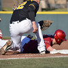 OU's Matt Oberste dives back to first to avoid being picked off Tuesday during the Sooners' game against Arkansas Pine bluff at L. Dale Mitchell Park.<br /> Kyle Phillips/The Transcript