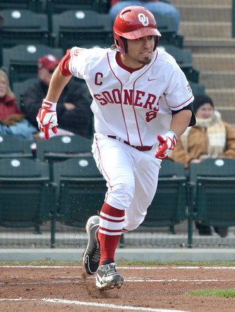 OU infielder Jack Mayfield takes off for first after hitting a ball during the Sooners' game against Hofstra Friday at L. Dale Mitchell Park.<br /> Kyle Phillips/The Transcript