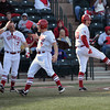 OU players celebrate after three players cross the plate on a hit by Anthony Hermelyn during the Sooners' game against Hofstra Friday at L. Dale Mitchell Park.<br /> Kyle Phillips/The Transcript