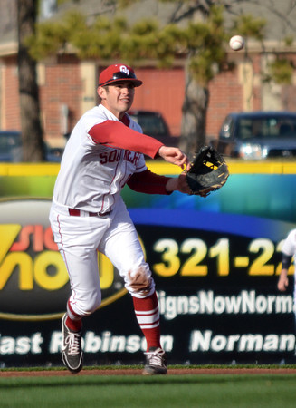 OU infielder Jack Mayfield throws the ball to first after picking up a ground ball during the Sooners' game against Hofstra Friday at L. Dale Mitchell Park.<br /> Kyle Phillips/The Transcript