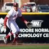 OU infielder Jack Mayfield picks up a ground ball during the Sooners' game against Hofstra Friday at L. Dale Mitchell Park.<br /> Kyle Phillips/The Transcript
