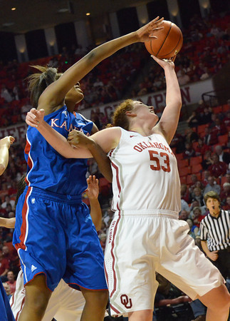 Oklahoma forward Joann McFarland (53) tries to get control of the ball before Kansas forward Chelsea Gardner (15) during the Sooners' game against the Jayhawks at the Lloyd Noble Center in Norman, Okla..<br /> Kyle Phillips/The Transcript