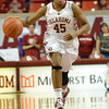 OU guard Jasmine Hartman drives down the court as the Sooners take on Kansas at the Lloyd Noble Center in Norman, Okla..<br /> Kyle Phillips/The Transcript