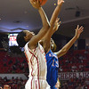 OU guard Sharane Campbell shoots the ball over Kansas forward Chelsea Gardner Saturday during the Sooners' game against the Jayhawks at the Lloyd noble Center in Norman, Okla..<br /> Kyle Phillips/The Transcript