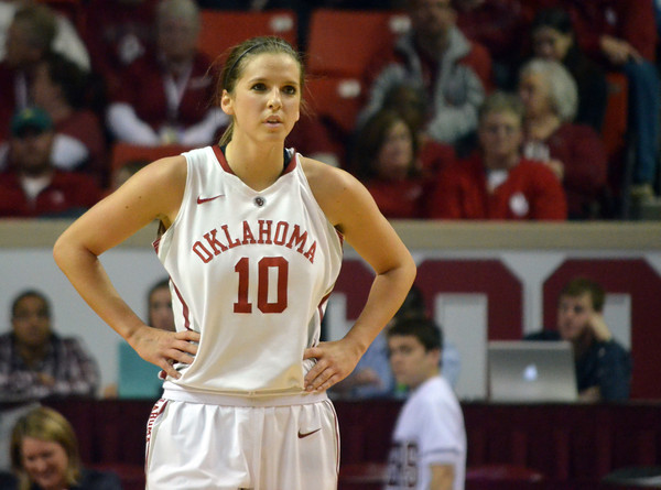 OU guard Morgan Hook takes a breather as a teammate shoots from the foul line Saturday during the Sooners' game against Kansas at the Lloyd Noble Center in Norman, Okla..<br /> Kyle Phillips/The Transcript