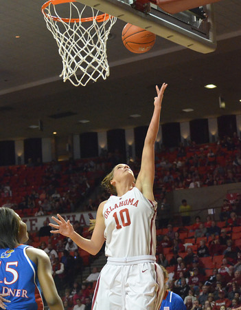 OU guard Morgan Hook puts the ball in the hoop as the Sooners take on Kansas at the Lloyd Noble Center in Norman, Okla..<br /> Kyle Phillips/The Transcript