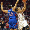 OU guard Jasmine Hartman shoots the ball past Kansas guard Charlicia Harper as the Sooners take on the Jayhawks at the Lloyd Noble Center in Norman, Okla..<br /> Kyle Phillips/The Transcript