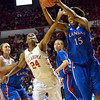 OU guard Sharane Campbell tries to get the ball away from Kansas forward Chelsea Gardner  as the Sooners take on the Jayhawks at the Lloyd Noble Center in Norman, Okla..<br /> Kyle Phillips/The Transcript