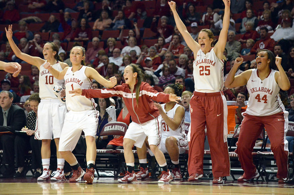The Oklahoma bench celebrates as the Sooners take the lead over Kansas Saturday during their game at the Lloyd Noble Center in Norman, Okla..<br /> Kyle Phillips/The Transcript