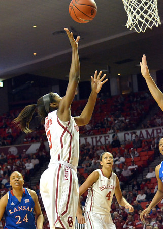 OU guard Aaryn Ellenberg puts the ball in the hoop as the Sooners take on Kansas at the Lloyd Noble Center in Norman, Okla..<br /> Kyle Phillips/The Transcript