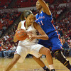 Oklahoma center Nicole Griffin tries to push past Kansas guard Charlicia Harper during the Sooners' game against the Jayhawks Saturday at the Lloyd Noble Center in Norman, Okla..<br /> Kyle Phillips/The Transcript