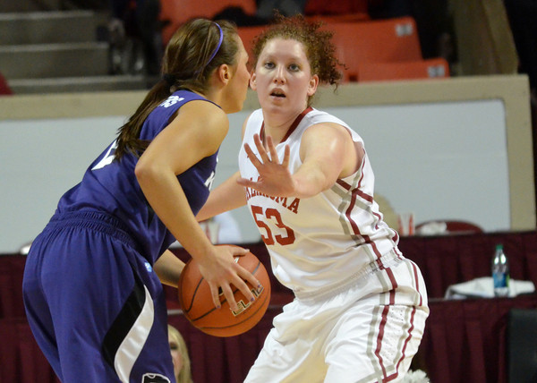 OU forward joanna McFarland guards Kansas State's Brittany Chambers Wednesday as the Sooners' take on the Wildcats at the Lloyd Noble Center in Norman, Okla..<br /> Kyle Phillips/The Transcript
