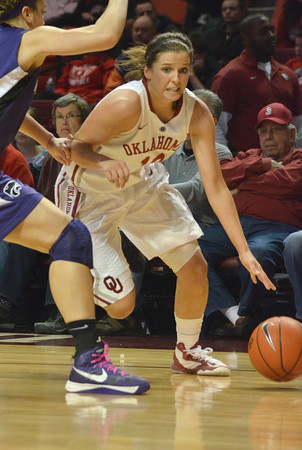 OU guard Morgan Hook (10) drives toward the goal Wednesday during the Sooners' game against Kansas State at the Lloyd Noble Center in Norman, Okla.<br /> Kyle Phillips/The Transcript