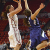 OU guard Morgan Hook (10) shoots over Kansas State's Brittany Chambers Wednesday during the Sooners' game against the Wildcats at the Lloyd Noble Center in Norman, Okla.<br /> Kyle Phillips/The Transcript