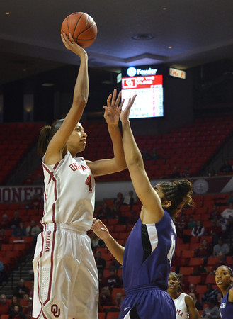 OU center Nicole Griffin shoots the ball over Kansas State's Chantay Caron  during the Sooners' game against the Wildcats Wednesday at the Lloyd Noble Center.<br /> Kyle Phillips/The Transcript