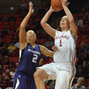 OU guard Nicole Kornet (1)  shoots the ball over Kansas State's Brittany Chambers (2)  Wednesday during the Sooners' game against Kansas State at the Lloyd Noble Center in Norman, Okla.