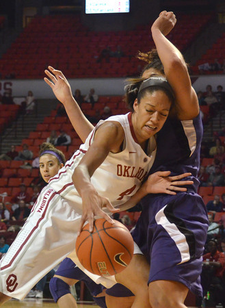 OU center Nicole Griffin tries to push past Kansas State's Chantay Caron as she goes to take a shot during the Sooners' game against the Wildcats Wednesday at the Lloyd Noble Center.<br /> Kyle Phillips/The Transcript