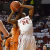 Oklahoma guard Sharene Campbell (24) takes a shot with a hand in her face Saturday during the Sooners' game against the Longhorns at the Lloyd Noble Center.<br /> Kyle Phillips/The Transcript