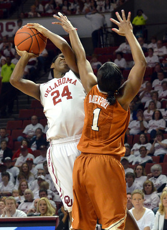 Oklahoma guard Sharane Campbell (24) shoots the ball over Texas guard Empress Davenport (1) Saturday during the Sooners' game against the Longhorns at the Lloyd Noble Center.<br /> Kyle Phillips/The Transcript