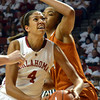 Oklahoma center Nicole Griffin (4) pushes around Texas center Imani McGee-Stafford (34) to take a shot Saturday during the Sooners' game against the Longhorns at the Lloyd Noble Center.<br /> Kyle Phillips/The Transcript