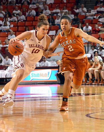 Oklahoma guard Morgan Hook (10) pushes past Texas guard Celina Rodrigo (2) as she drives down the court Saturday during the Sooners' game against the Longhorns at the Lloyd Noble Center.<br /> Kyle Phillips/The Transcript